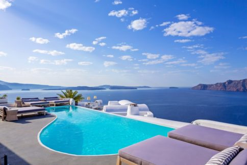hotels in heaven katikies greece pool stunning view endless white sky clouds pool view sea hill deckchair