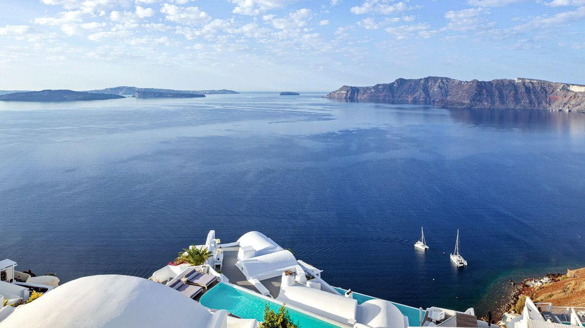 hotels in heaven katikies greece view location sea ocean sky clouds pool stone plant luxury hotel boat deckchair view flower