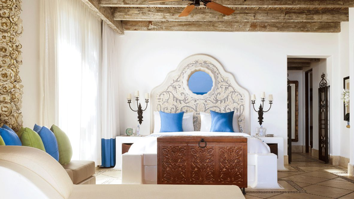 hotels in heaven las ventanas al paraiso bedroom private luxury hotel bed pillow candle couch chest mirror glass water bottle flower room blanket curtains