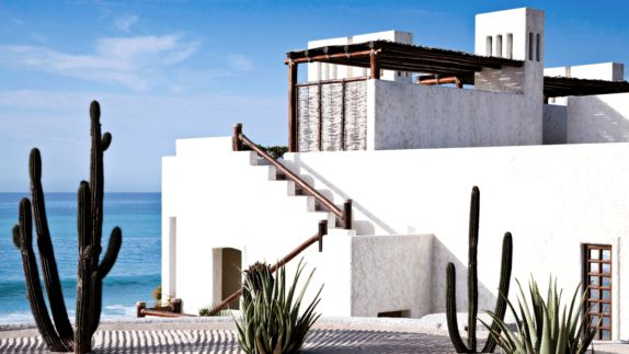 hotels in heaven las ventanas al paraiso bungalow guesthouse private accommodation white house cactus sea beach view window sunny sky clouds plants