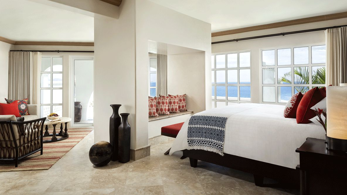 hotels in heaven one and only palmilla bedroom luxury bed windows vase pillow chairs balcony view sea beach palmtrees table lamp light summer