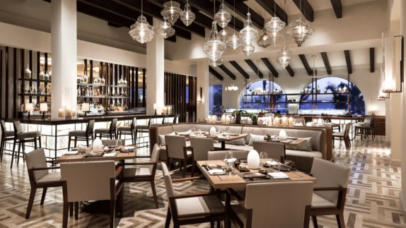 hotels in heaven one and only palmilla restaurant culinary dining luxury lights smart bar dishes table chair inside