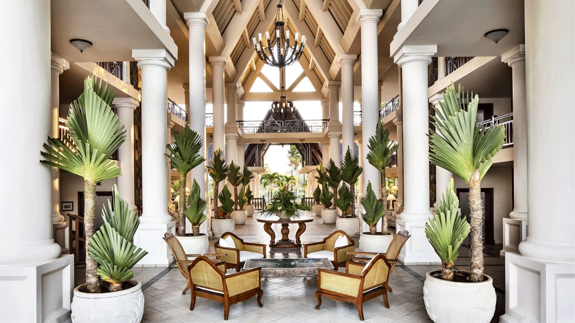 hotels in heaven residence mauritius lobby lounge accommodation chair wood plants balcony luxury pillar