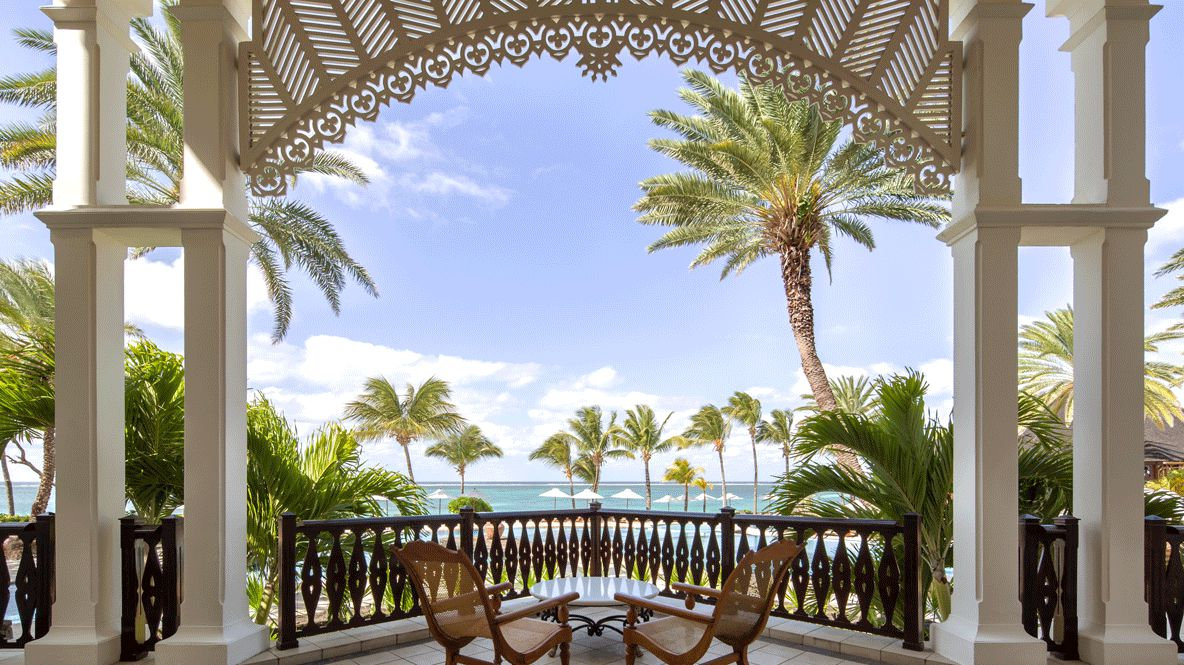 hotels in heaven residence mauritius ocean view terrasse palmtrees sunshade sky clouds chair table private