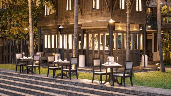 hotels in heaven the siam culinary restaurant open air palm tree napkin flower plate chair table outside meadow stair