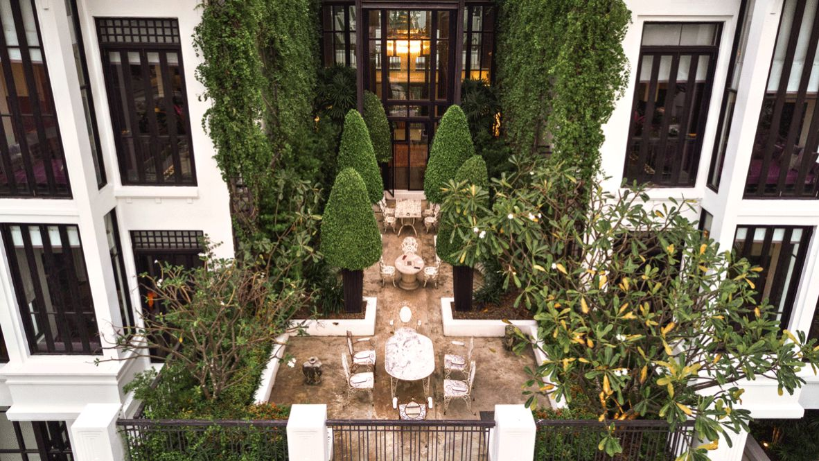 hotels in heaven the siam culinary terrace table chair tree window beautiful plants hedgerow