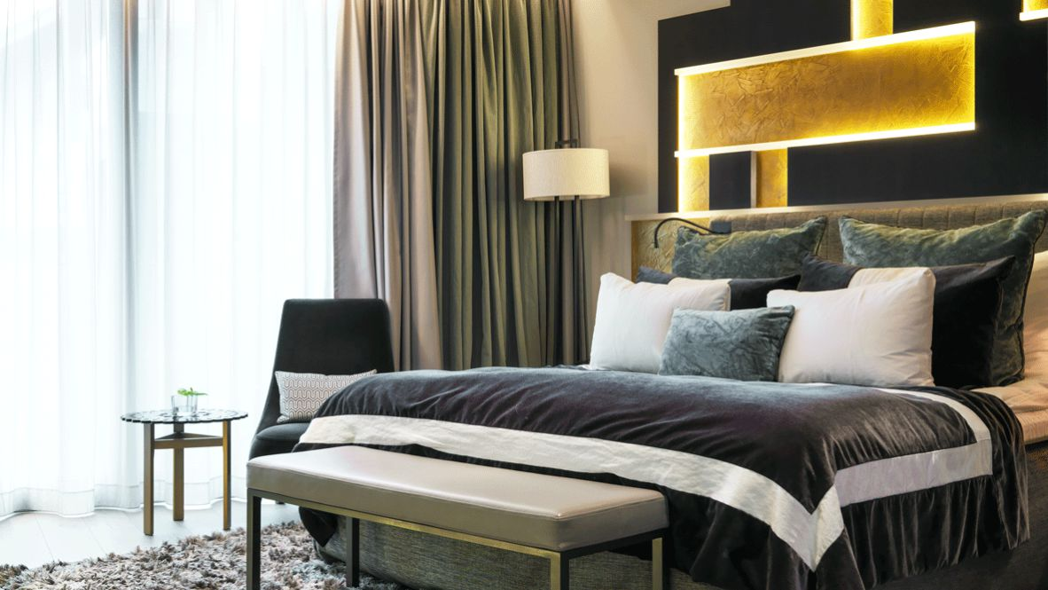 hotels in heaven the thief bedroom private suite luxury grey comfort pillow bed blanket cupboard carpet nightstand chair