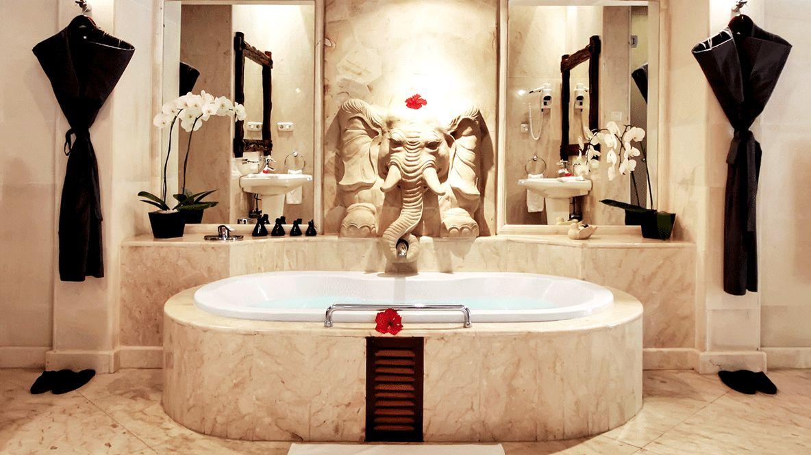 hotels in heaven viceroy bali spa bath tub wellness indoor elephant bathroom plants sink hairdryer gown towel