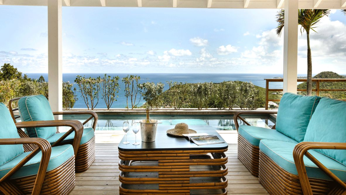 hotels in heaven villa marie saint barth private pool suite view blue furniture tree glass sparkling wine noble hat sky clouds sea hill blue decoration magazine