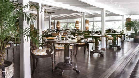 hotels in heaven villa marie saint barth restaurant culinary noble wood furniture wine glass plate plants chair table dinner luxury