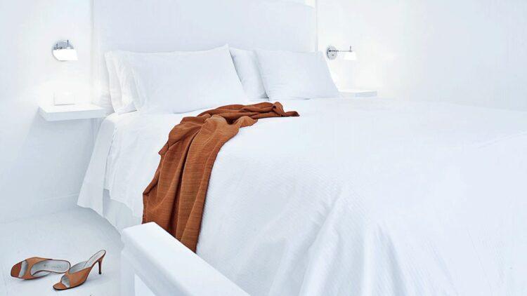 hotels in heaven katikies greece bedroom png white heels light bed lake pillow lamp dress