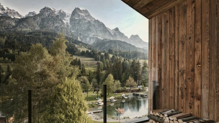 hotels in heaven hotel forsthofgut room with a view mountain snow pool deckchair tree wood nature beautiful sky