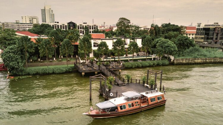 hotels in heaven the siam location view bridge river boat tree houses deckchair lights
