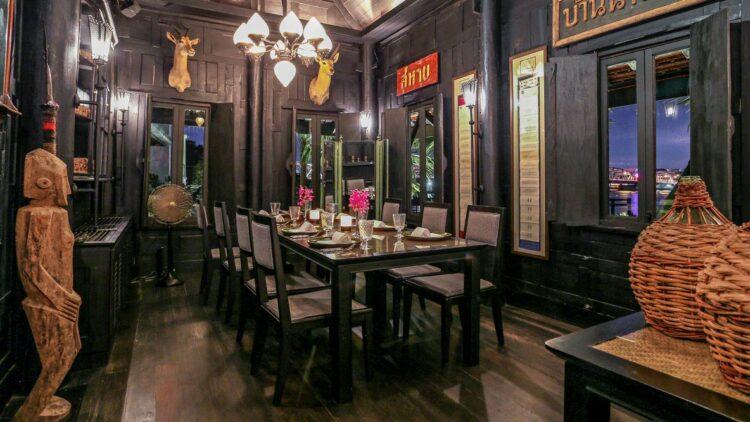 hotels in heaven the siam restaurant glass plate dinner figure deer table chair flower vase ventilator window view