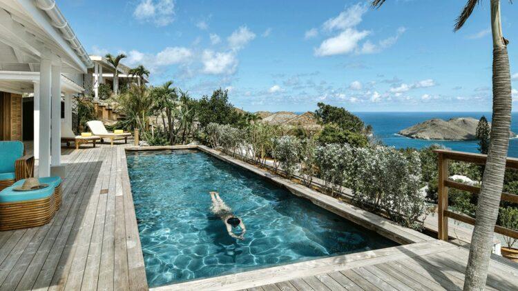 hotels in heaven villa marie saint barth outdoor pool ocean view swimming deckchair sun plants tree sea sky clouds