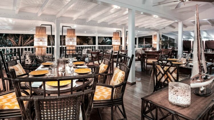 hotels in heaven villa marie saint barth restaurant dining culinary wine glass table chair boat figure noble candle light terrace plants luxury