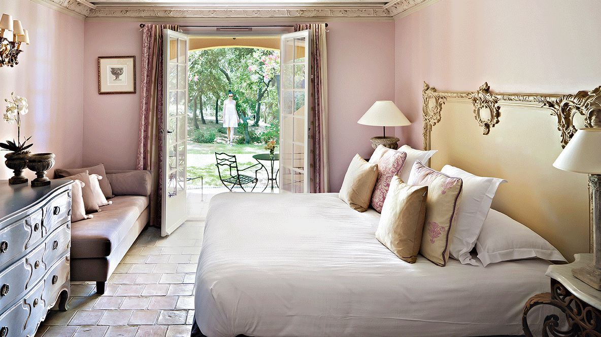 hotels in heaven Villa Marie bedroom luxury view suite bed lake pillow lamp noble pink plants garden woman tree couch