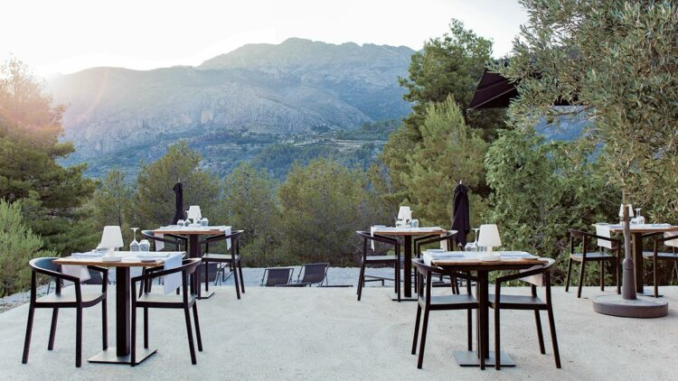 hotels in heaven guadalest vivood culinary restaurant outdoor dishes wine glass lamp view mountain sun tree table chair sunshade dinner