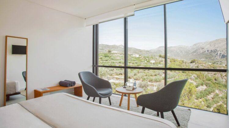 hotels in heaven guadalest vivood private suite bedroom nie view chair view relaxed mirror bed lake mountains nature tv