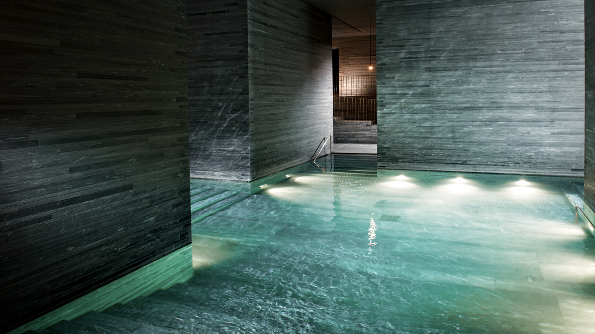 hotels in heaven 7132 spa pools water turquoise relaxing calm dark few lights stone walls darker stairs