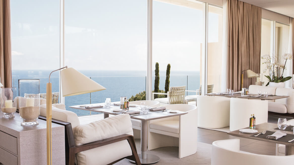 hotels in heaven La Reserve Ramatuelle culinary dining restaurant food trees outdoors view armchairs tables glasses