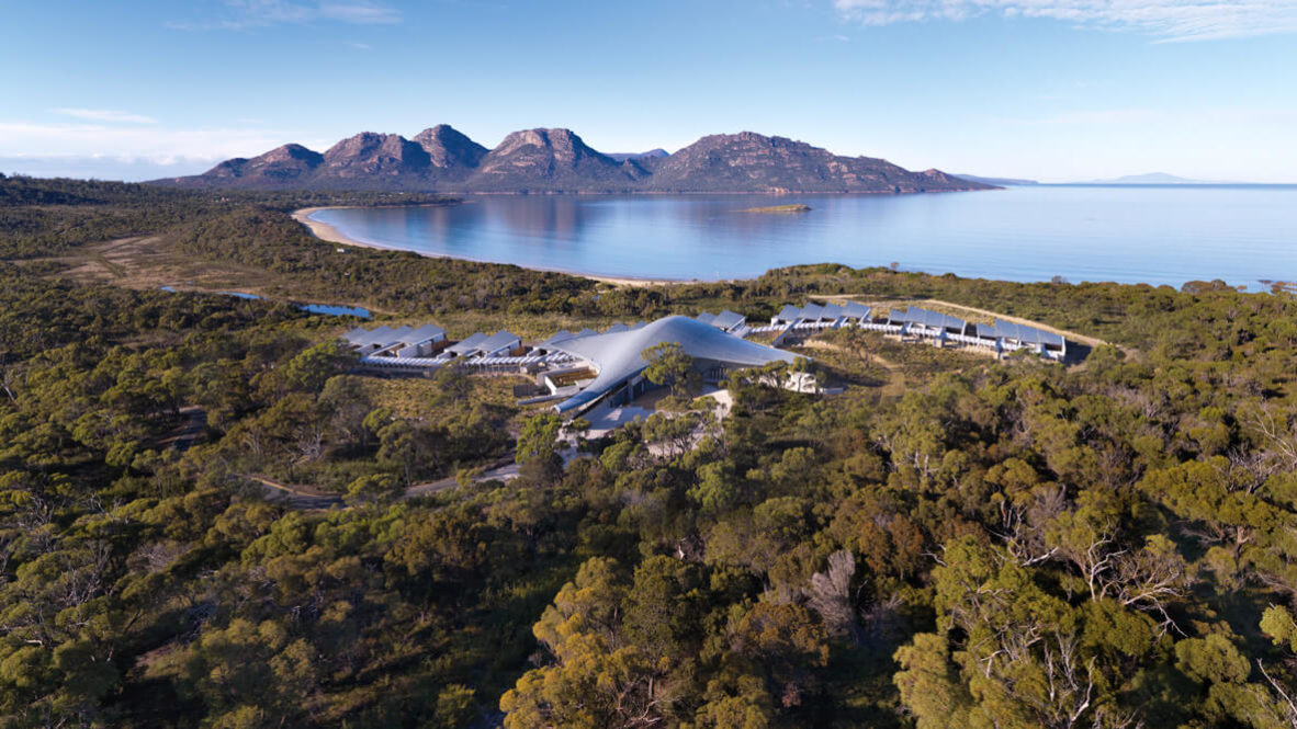hotels in heaven saffire freycinet accommodation drone shot ocean water overview outdoors trees bushes mountains hills sky