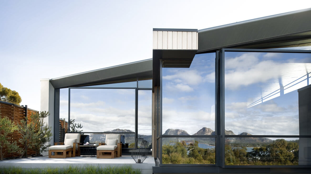 hotels in heaven saffire freycinet accommodation luxury unique glass mirror sky cloudy sky lounger cushions