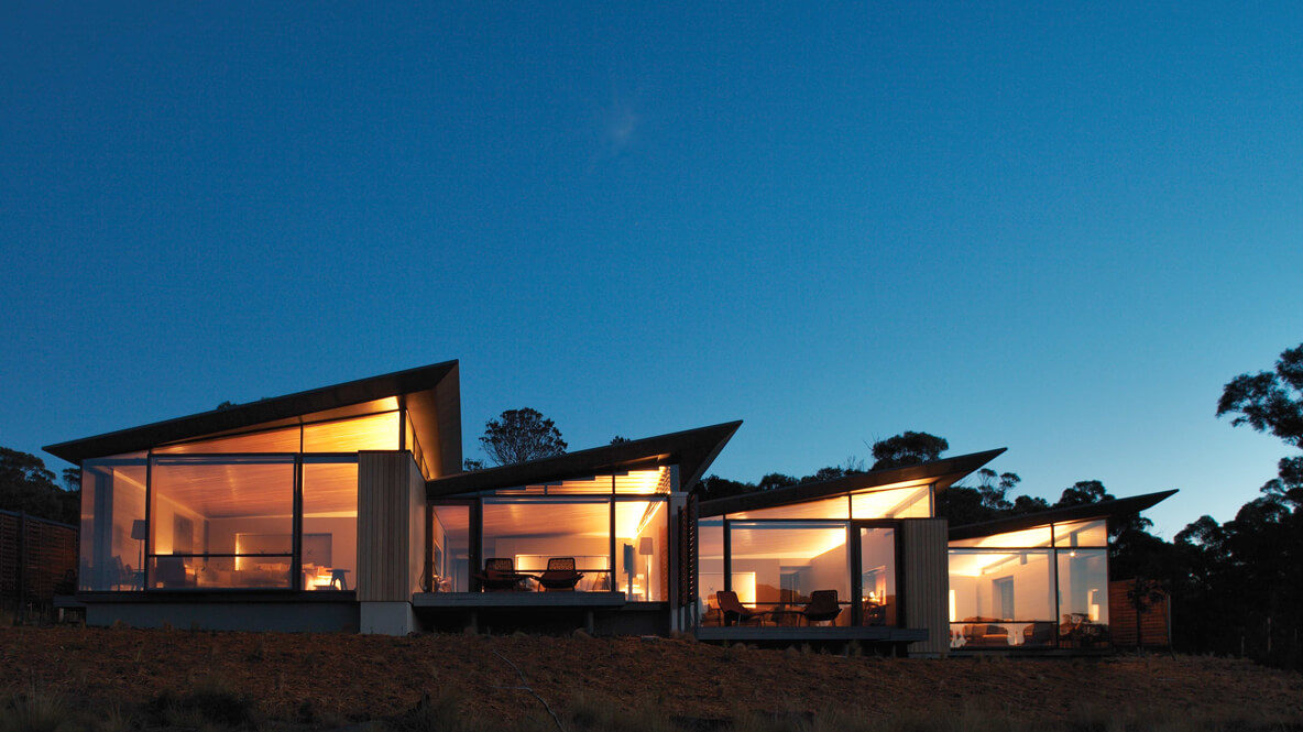 hotels in heaven saffire freycinet accommodation night nighttime lights lamps front view sky trees evening grass