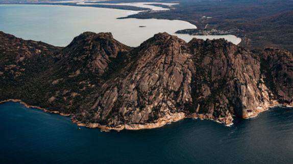 hotels in heaven saffire freycinet location australia outback rocky rocks hills ocean water overview trees boats