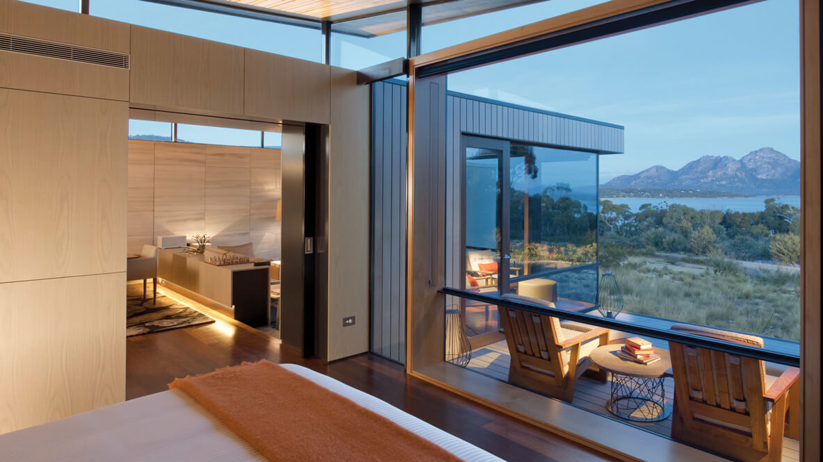 hotels in heaven saffire freycinet room with a view armchairs blanket bed lamps outdoors terrace mountains ocean trees