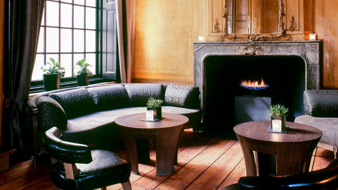 hotels in heaven the dylan amsterdam culinary lounge exclusive palnts sofa black wooden table fireplace candles mirror