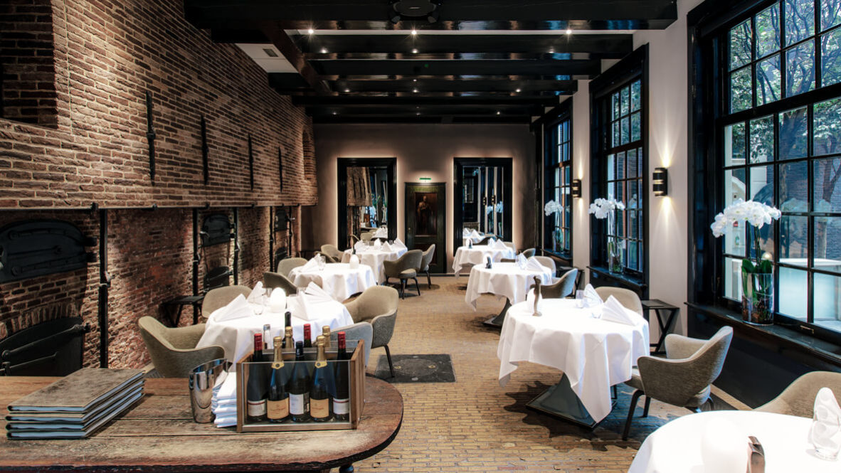 hotels in heaven the dylan amsterdam culinary restaurant wine bottles champagne white table cloths dinner dining armchairs
