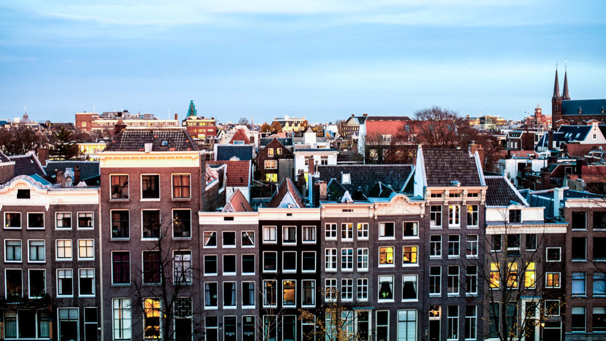 hotels in heaven the dylan amsterdam location view skyline windows houses city sky foggy morning sunrise roofs