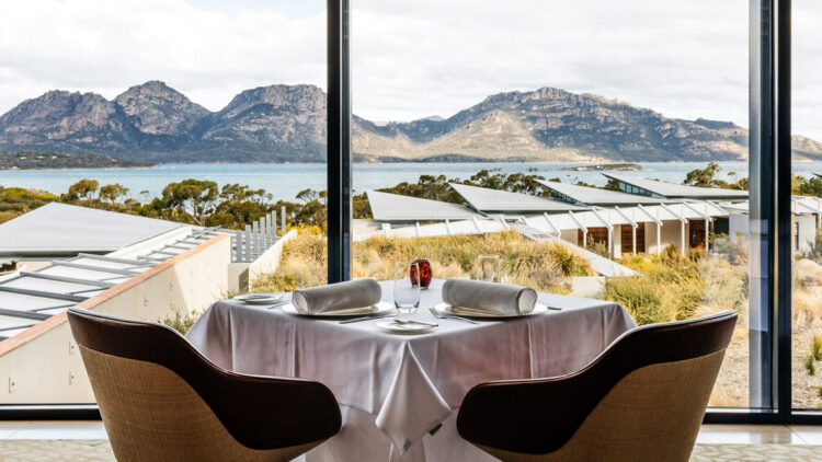 hotels in heaven saffire freycinet culinary dining with a view water glasses armchairs dinner table tablecloth mountains