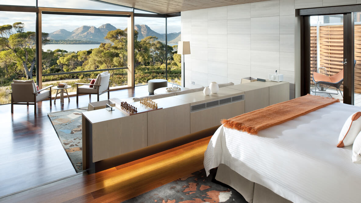 hotels in heaven saffire freycinet accommodation room suite trees view armchairs chess field vases mountains grass blanket