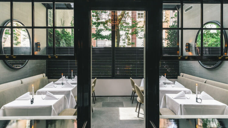 hotels in heaven the dylan amsterdam culinary dining restaurant indoor round mirrors white table cloths candles napkins
