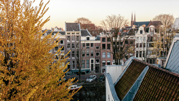 hotels in heaven the dylan amsterdam location view cars trees street river water roof houses windows morning sun