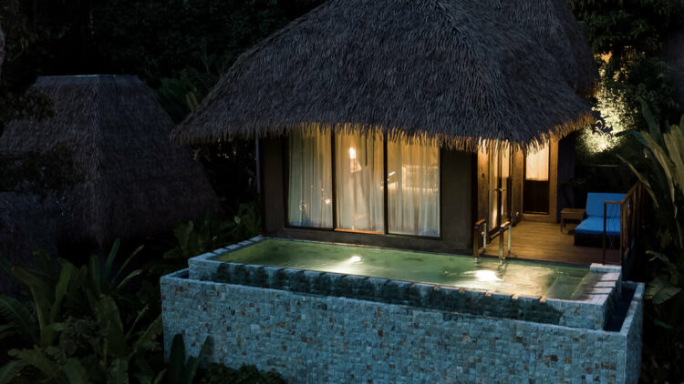 hotels in heaven keemala accommodation outdoor private pool night time dark lights comfy beautiful shack water windows