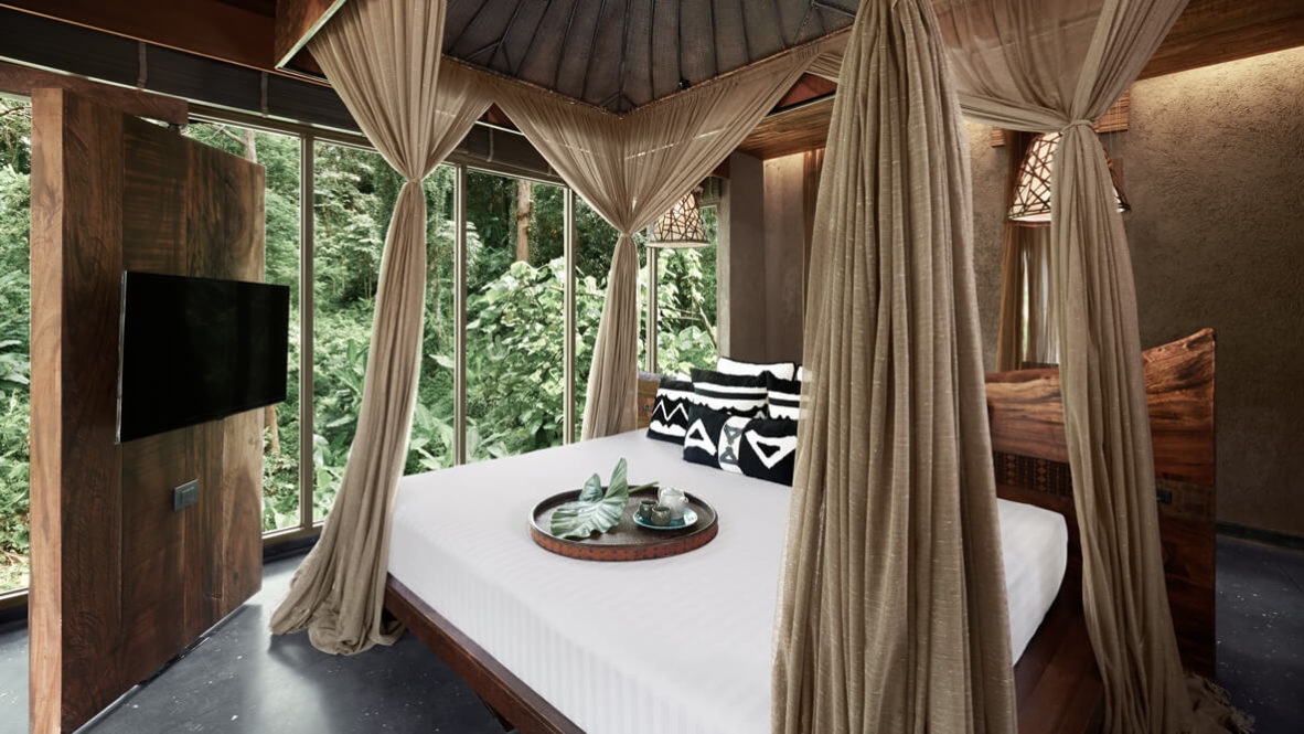 hotels in heaven keemala accommodation suite bedroom linen blanket pillow television window trees comfy lamp wooden walls