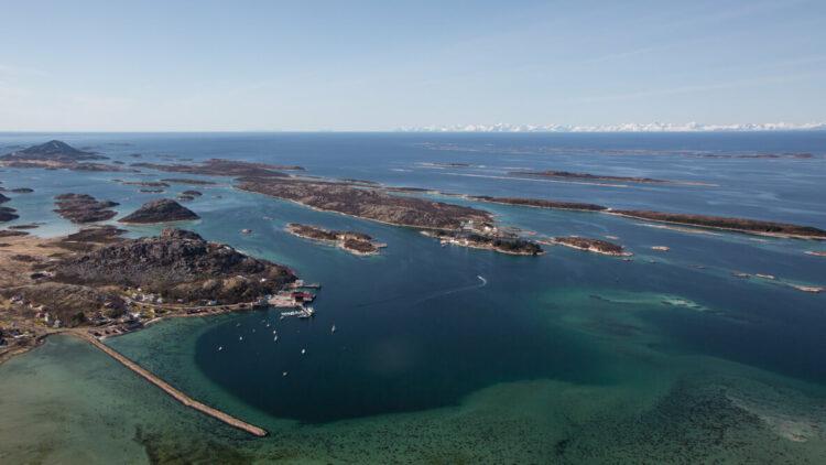 hotels in heaven manshausen location drone shot birdeye view outside outdoors overview islands boat water dark blue sea