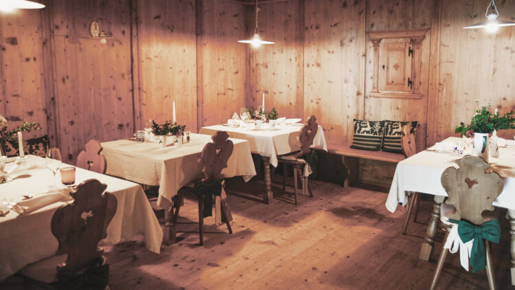 hotels in heaven miramonti boutique stube culinary wood wooden floor wall chairs nice lamps rustic cute candles romantic dinner