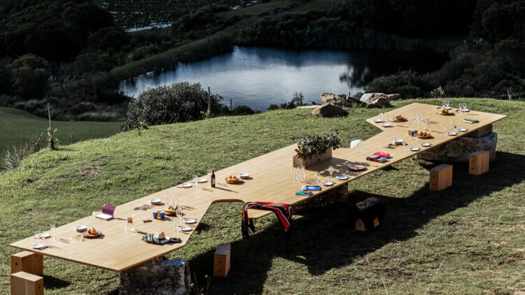 hotels in heaven sacromonto culinary dining table outdoor pond dinner grass bushes rustic comfy big interesting