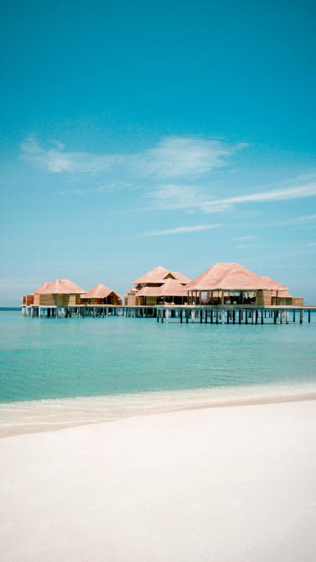 hotels in heaven-overwater villas-sandy beach-turquoise water