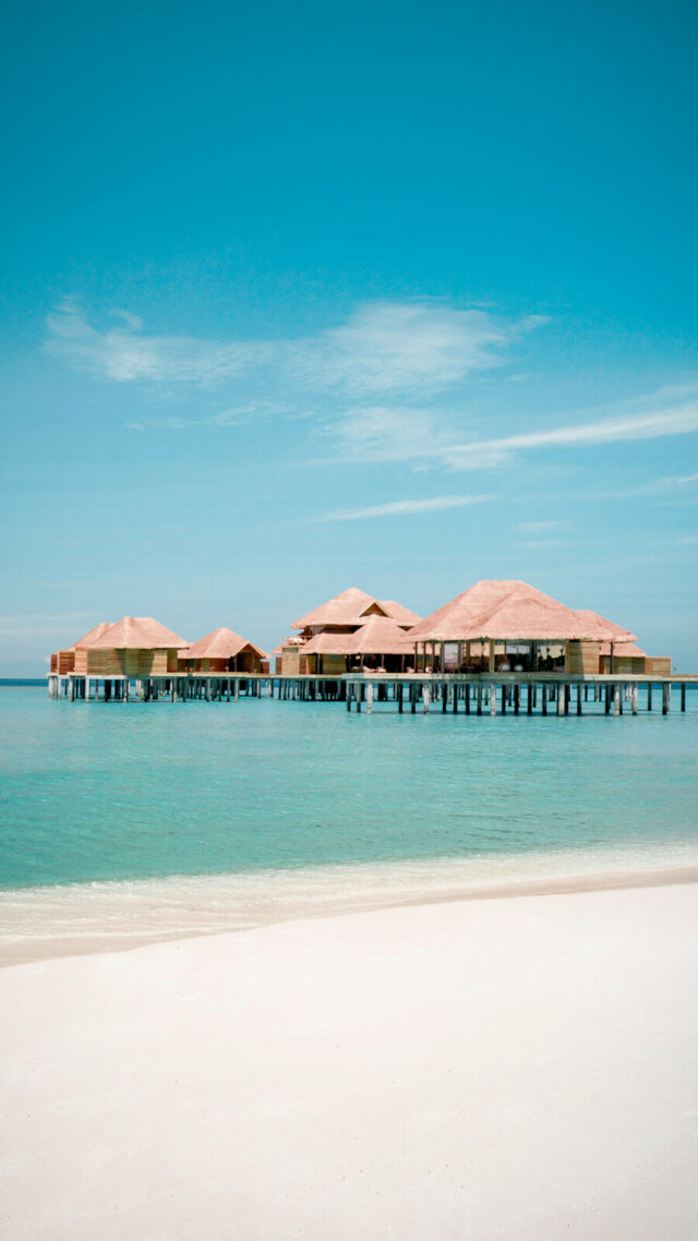 hotels in heaven-overwater villas-sandy beach-turquoise water