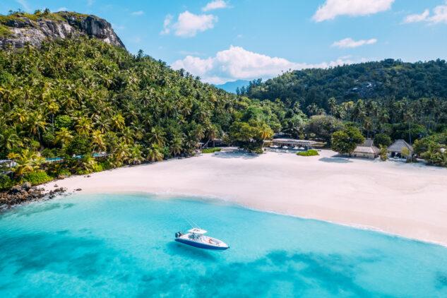 north-island-seychelles-beach-boat