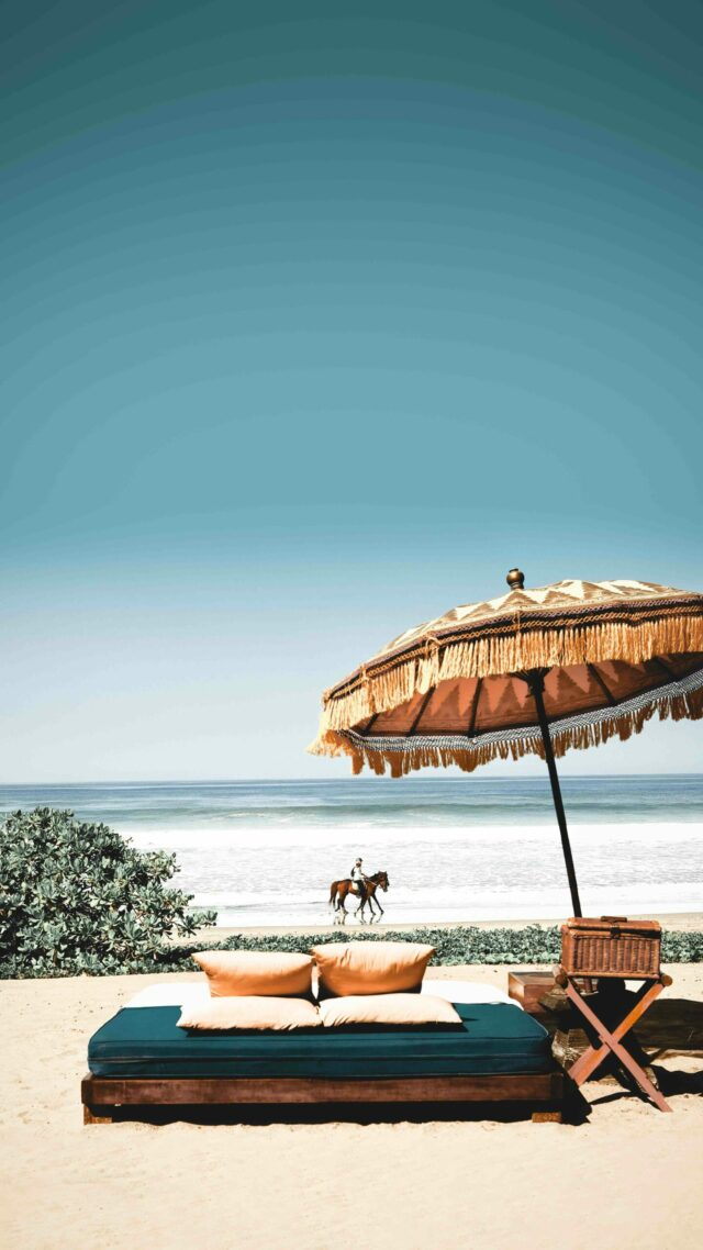 lounging at the beach-the oberoi beach resort bali