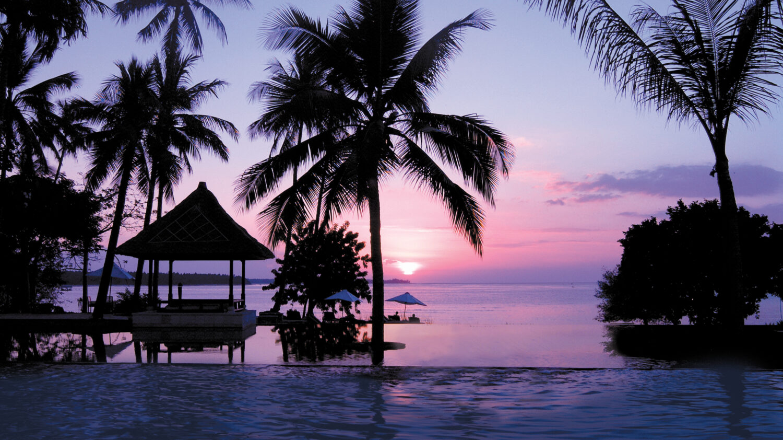 sunset pool view ocean-the oberoi beach resort lombok