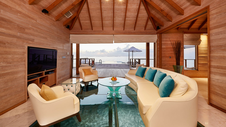 livingroom sunset water villa-conrad maldives