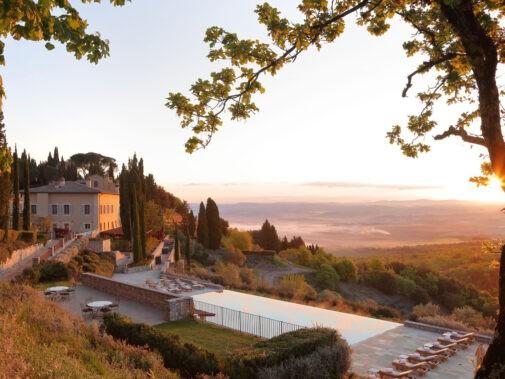 rosewood-castiglion-del-bosco-borgo-pool-sunrise
