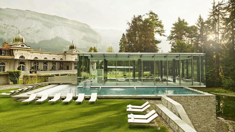 waldhaus-flims-pool-front-summer-view